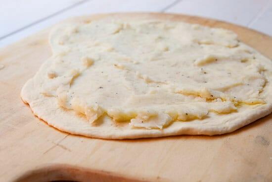 Adding the mashed potatoes - Mashed Potato Pizza
