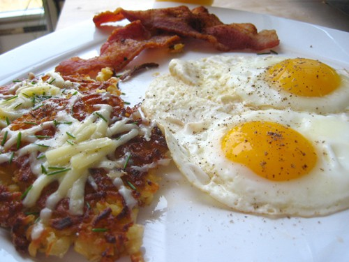 How hashbrowns should be eaten. With bacon and eggs.