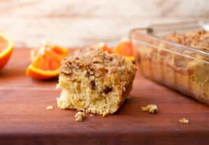 Orange Coffee Cake: Delicious coffee cake with a crunchy crumb topping and laced with citrus flavors. Perfect with tall cup of coffee or just have a slice for dessert! | macheesmo.com