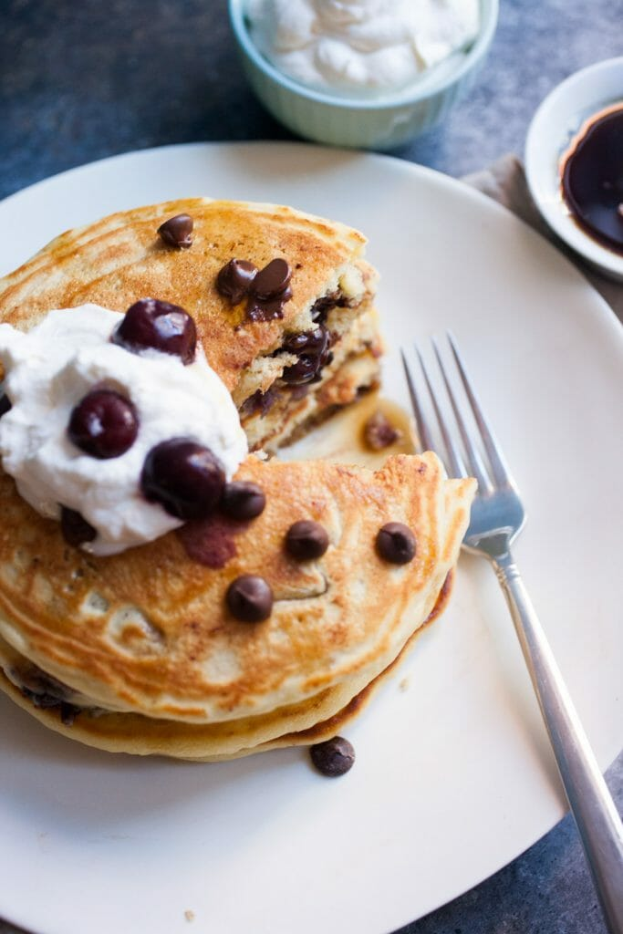 Cherry Chocolate Pancakes: A delicious buttermilk pancake recipe based on my favorite Ben and Jerrys ice cream flavor! So amazing! | macheesmo.com