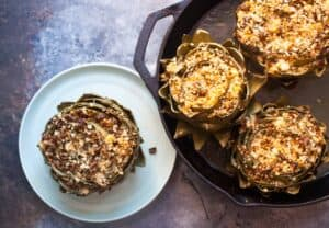 Stuffed Artichokes: These roasted artichokes are stuffed with a mix of delicious flavors like sun-dried tomatoes, feta, and basil. What a great appetizer! | macheesmo.com
