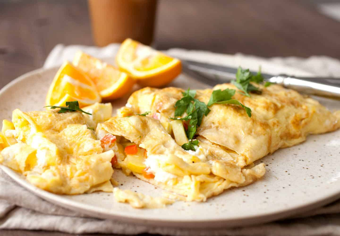 Diner-Style Griddle Omelet: This is how to make a super-packed diner-style omelet at home using your griddle! One of my favorite quick breakfasts! | macheesmo.com