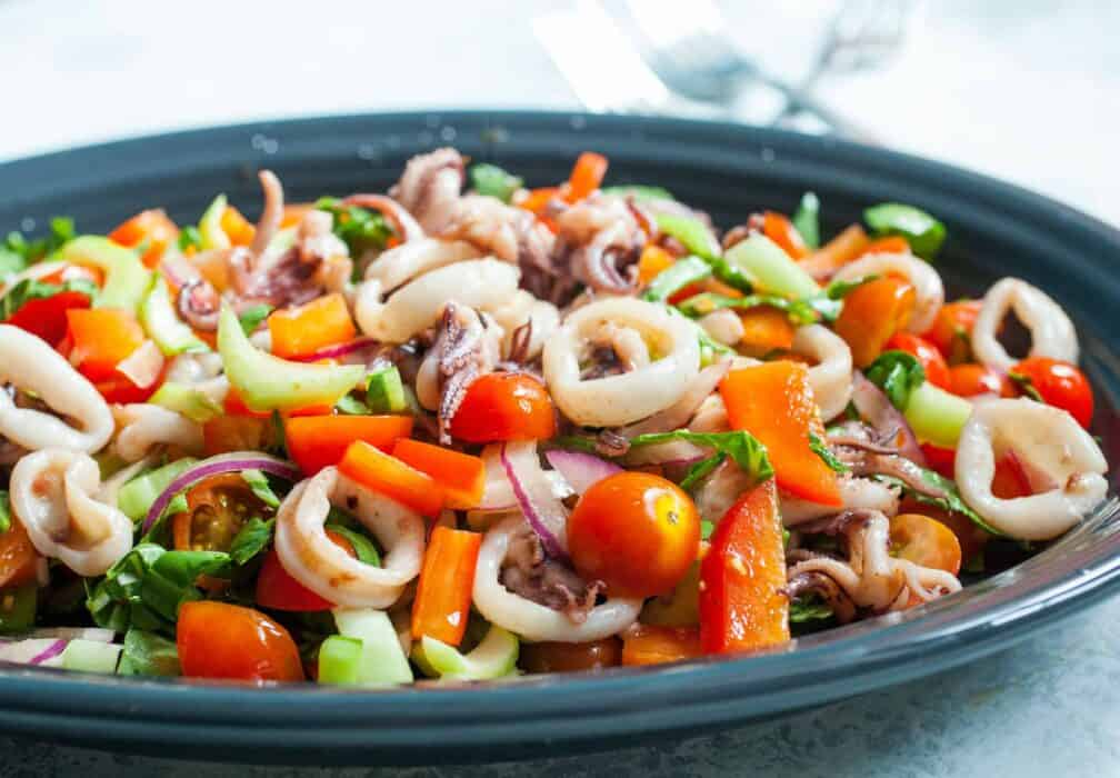 Calamari Salad: Loads of fresh vegetables tossed with quick-seared calamari makes for a delicious and light seafood salad. | macheesmo.com