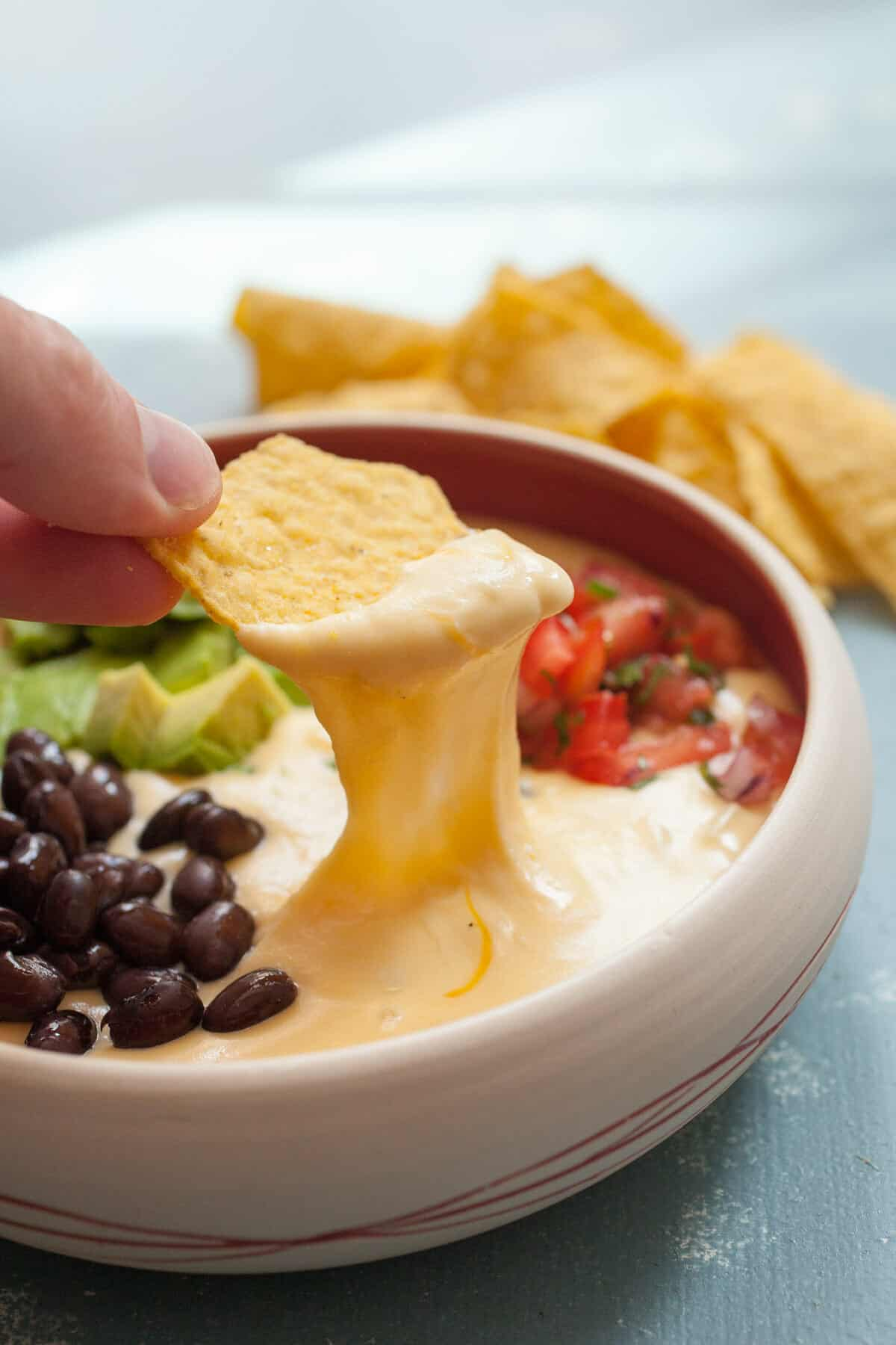 "Macheesmo Mud Queso: This queso is jam-packed with add-ins and when you stir it all together you end up with ""mud"". Something that is very delicious on chips. You'll see. 