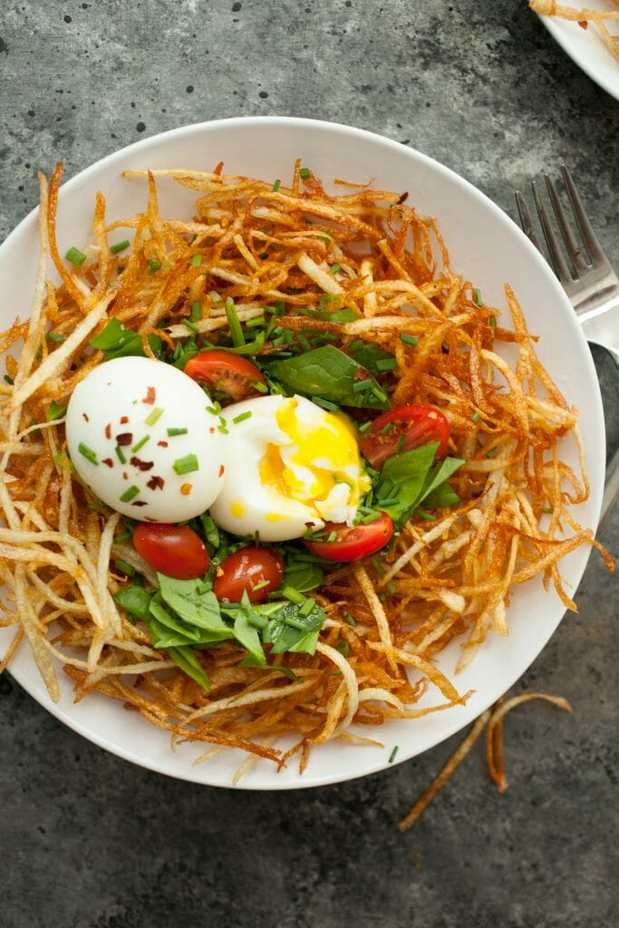 Bird's Nest BreakfastS: Thin fried slivers of potato layered with a few veggies and soft-boiled eggs. A fun and very delicious breakfast! | macheesmo.com