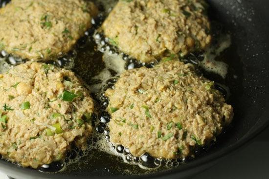 frying chickpea patties