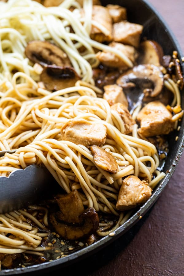 Tossing everything together for chicken and mushroom lo mein