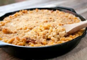 Cast Iron Macaroni and Cheese: A made-from-scratch mac and cheese with just enough bacon and spice, mixed together and baked in a cast iron skillet for crispy edges!