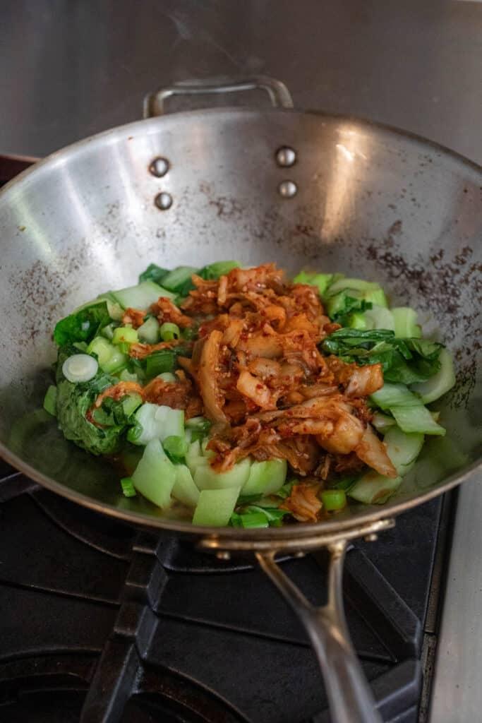 Kimchi added to wok for stir fry.