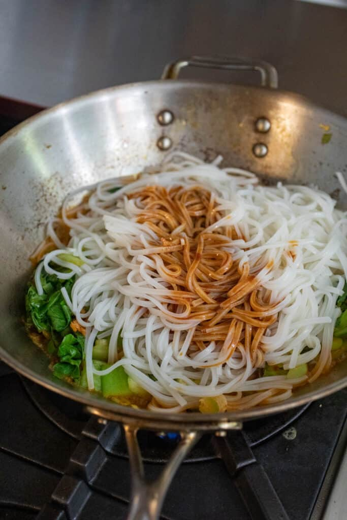 Rice noodles and sauce added.