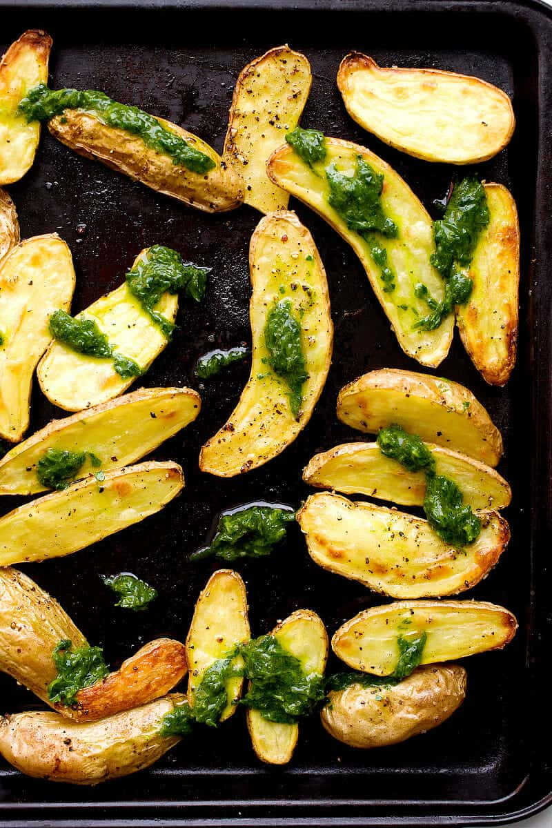 Roasted Fingerlings with Chive Pesto: Crispy roasted fingerling potatoes (they cook quickly) tossed with a simple chive pesto - packed with flavor! This is the side dish that potato lovers will have dreams about. | macheesmo.com