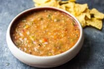 Easy grilled salsa with fresh tomatoes, tomatillos, onions, and sweet peppers. All charred on a grill and blended together. The best salsa you'll have this summer and easy to make!