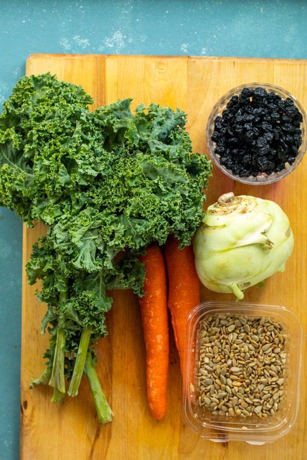 The basics for kale slaw including carrots and kohlrabi.