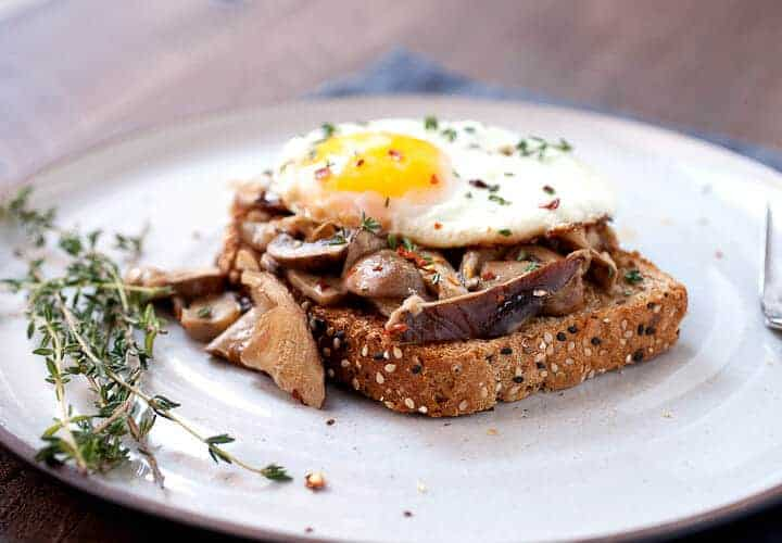 Creamed Mushrooms on Toast: One of my favorite simple breakfasts. Good hearty mushrooms, simply sauteed in olive oil with a few spices and simmered in a little cream. Piled onto sturdy toast with a few eggs! | macheesmo.com