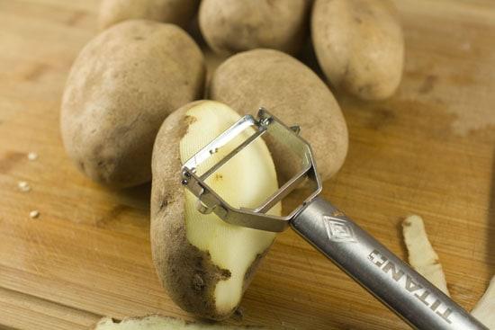potatoes peeled for Spicy Potato Tapas