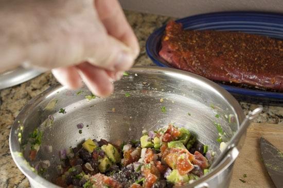 seasoning the salad - Quick Carne Asada