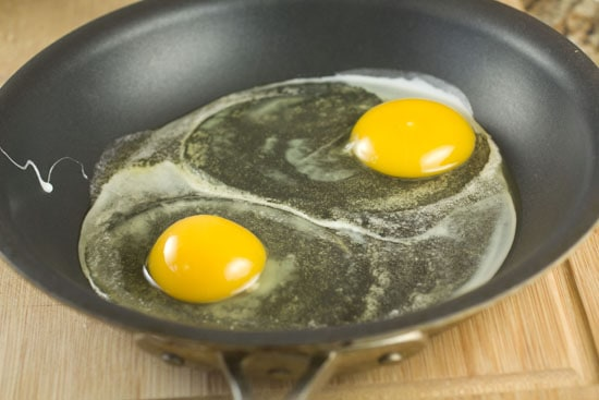 eggs cooking in pan for Ricotta Breakfast Sandwich