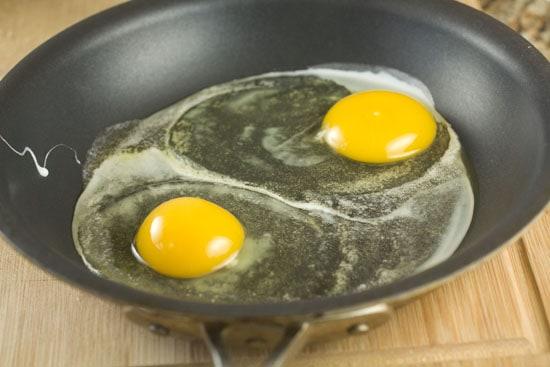 eggs cooking in pan for Ricotta Breakfast Sandwich