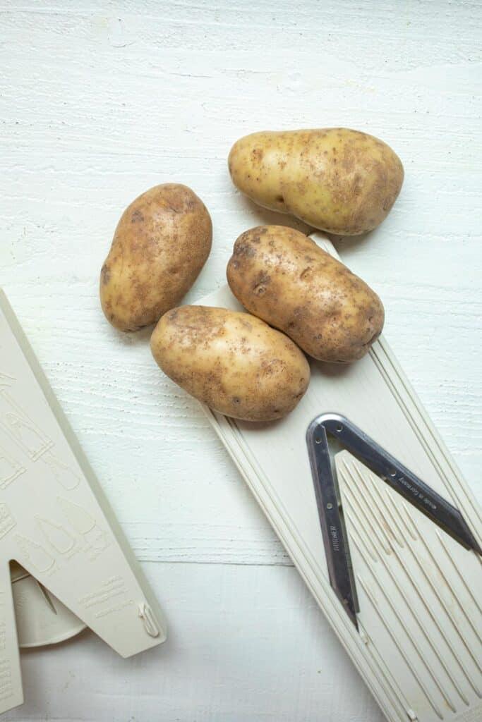 Slicing potatoes with Mandolin slicer