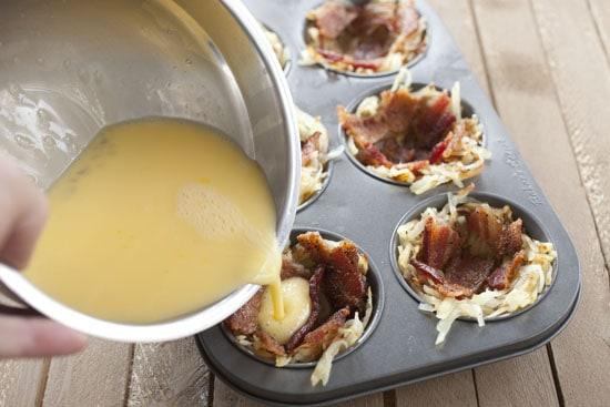 eggs going in - Breakfast Potato Cups