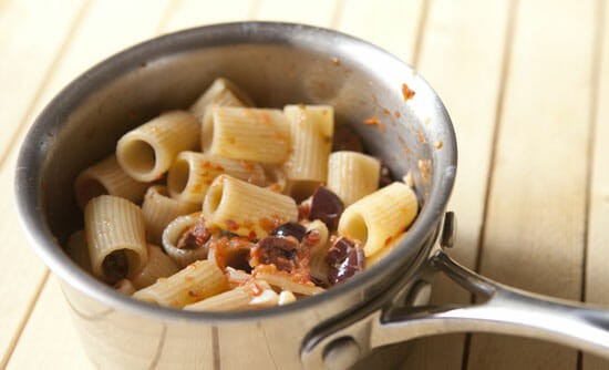 Pasta tossed with our Puttanesca Sauce