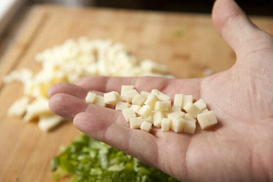 Get the cheese into small cubes for Escarole Barley Salad