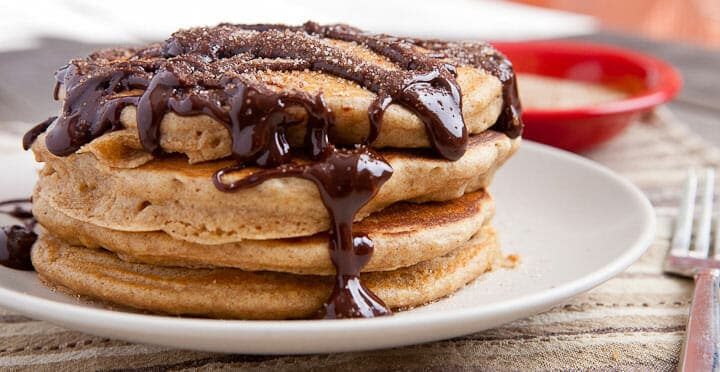 Churro pancakes with spicy chocolate sauce.