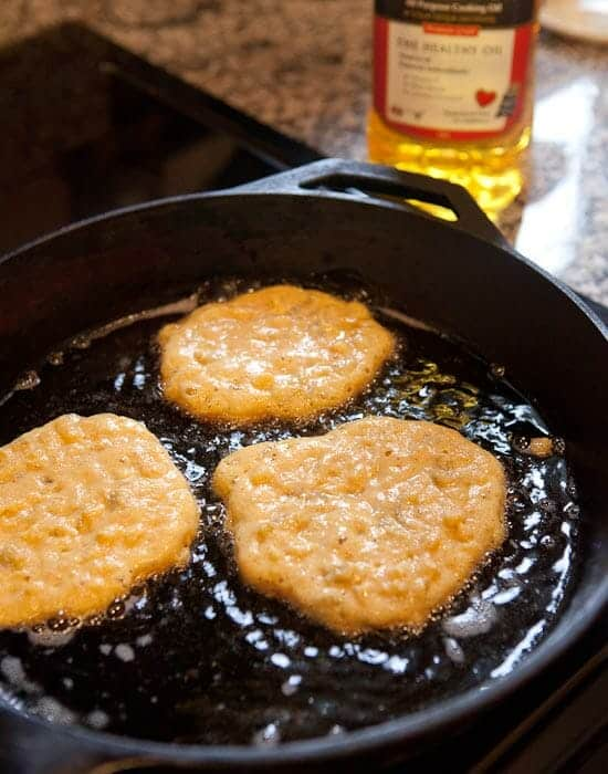 corn griddle cakes frying.