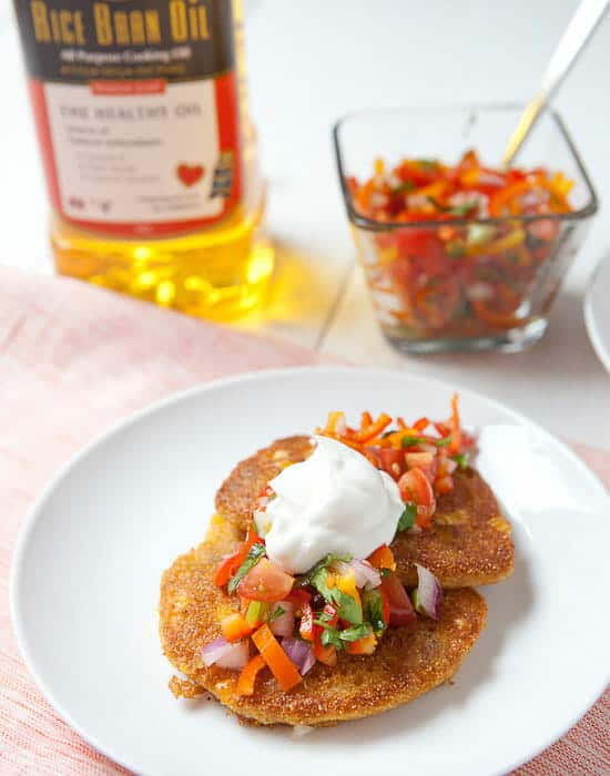 Corn Griddle cakes with fresh sweet pepper salsa and sour cream.