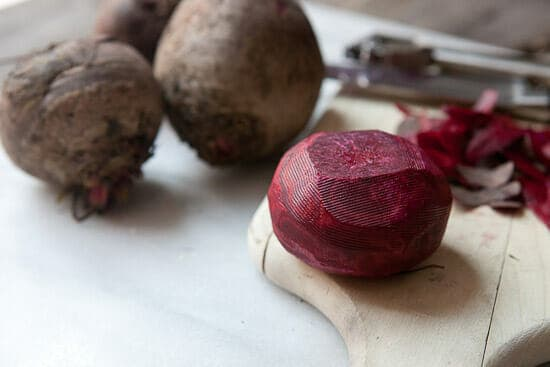 peeling the beets for Balsamic Roasted Beets