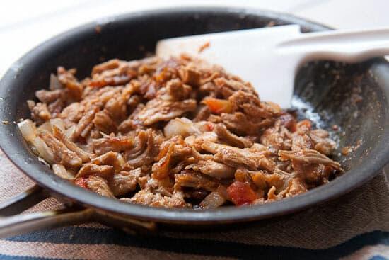 Crisping pork tinga.