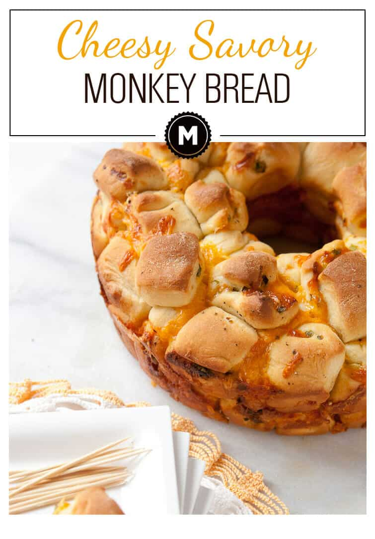 Cheesy Monkey Bread: Easy-to-make homemade dough rolled with cheese and scallions and baked. The finished savory bread is easy to snack on... too easy to snack on almost!