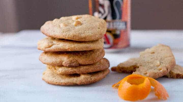 Orange White Chocolate Cookies - Packed with chocolate chips and orange zest and seasoned with a reduced white ale honey. Be sure to check out the secret spice that takes these cookies over the edge!