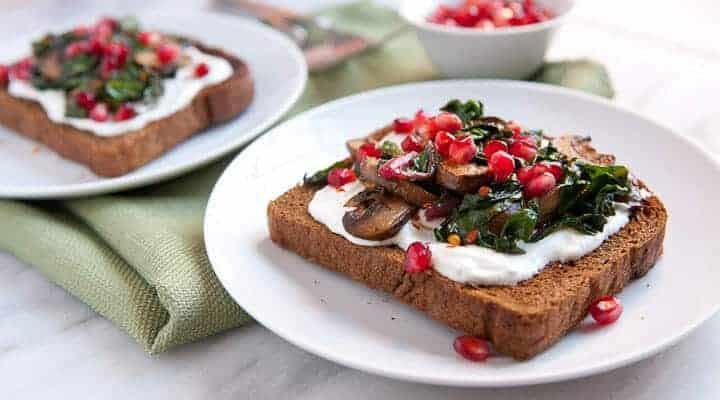 Savory Mushrooms on Toast: Sauteed mushrooms and Swiss chard served over crispy pumpernickel toast with some bonus goodies packed on!