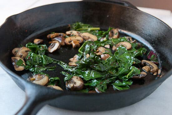Cooking mushrooms on toast.