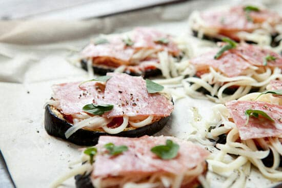 Easy eggplant pizzas topped.
