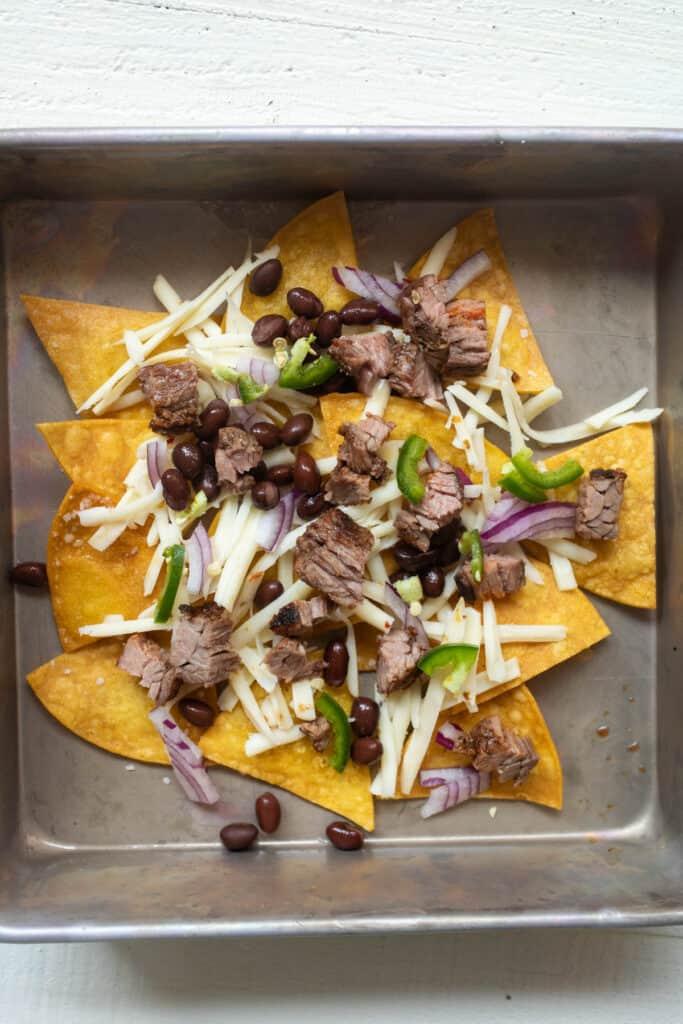 Layer one of carne asada nachos