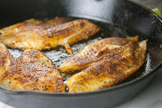 Cooked blackened tilapia for fish tacos.