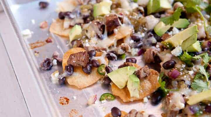 Heart-Shaped Carne Asada Nachos! A fun twist on classic nachos with homemade heart-shaped chips and a spicy carne asada topping!