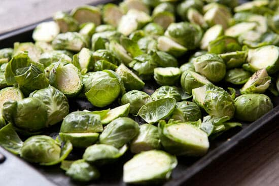 Roasting spicy brussels sprouts.