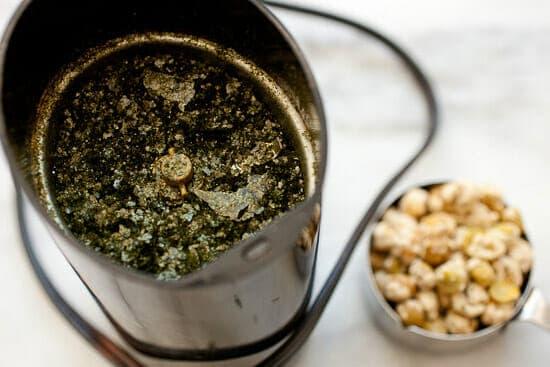 Grinding seaweed seasoning.
