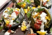 Tex-Mex Breakfast Stuffed Peppers: Roasted Poblano peppers stuffed with eggs, corn strips, corn, queso fresco, salsa, and a light sour cream sauce! This is one good breakfast pepper! | macheesmo.com