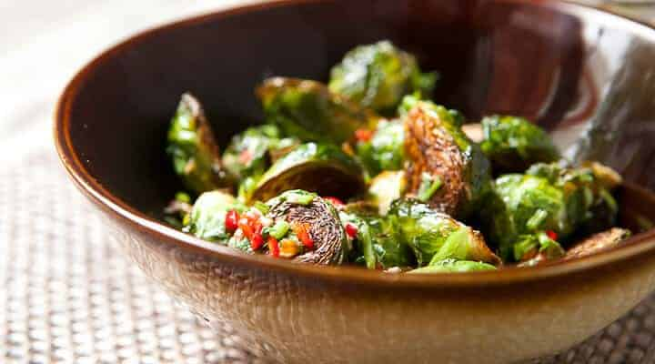 Genius Crispy Brussels Sprouts with Fish Sauce: These are the brussels sprouts of your dreams. Beautifully crispy, but tender on the inside and tossed with a salty fish sauce vinaigrette. From the Food52 Genius Recipes Cookbook! | macheesmo.com