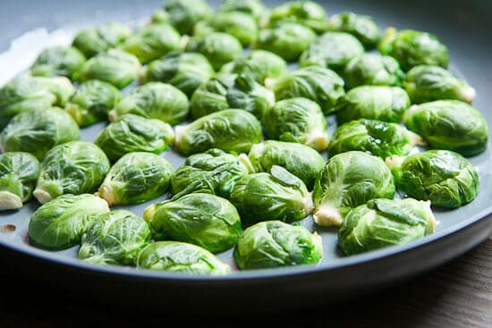 Searing crispy Brussels Sprouts.