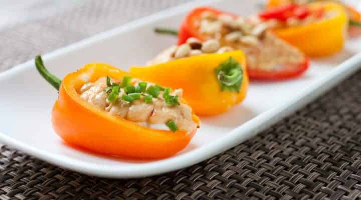 Stuffed Sweet Peppers: Whipped goat cheese and spicy hummus layered in crunchy, crisp sweet peppers and topped with various garnishes. The perfect, quick summer appetizer!