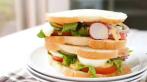 "Summer Salad Sandwiches: Soft white sandwich bread, all the crunchy, crispy veggies of summer, and a lightly tangy salad cream dressing makes for one great sandwich! From ""A Girl and Her Greens"" Cookbook!"