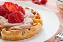 Strawberry Waffles with Nutella Whipped Cream: Fresh strawberries stuffed inside a waffle and served with mounds of fresh whipped Nutella cream and piles of strawberries! The perfect summer waffle.