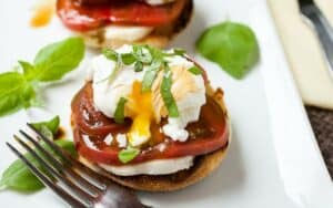 Caprese Breakfast Sandwiches: In the summer, I'm always on the hunt for quick breakfasts featuring super-ripe tomatoes. This recipe skips some of the heaviness of an eggs benedict and just focuses on ripe tomatoes and good ingredients. Keep the poached egg though!
