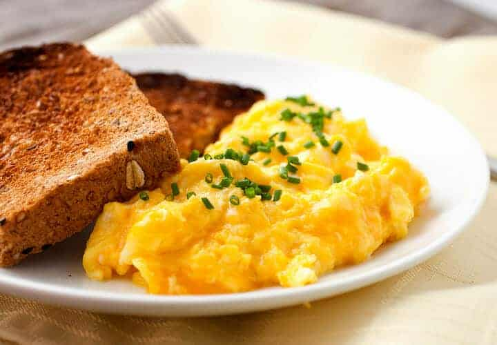 How to Make Perfect Cheesy Eggs every time! The true key to cheesy eggs is all about temperature control. Once you get it down you can use a bunch of different cheeses for different results!