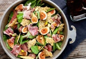 Fresh fig salad w/ Crunchy Parmesan Chips: This is one of my favorite ways to eat fresh figs which are only ripe and available in late summer. The salad is light, but with big flavors including pistachios, proscuitto, and crunchy homemade parmesan chips. It's beautiful and delicious! | macheesmo.com